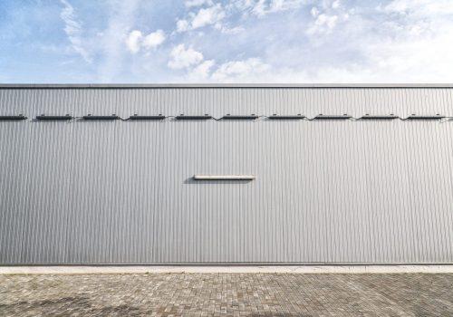 metallic-sheet-on-a-modern-industrial-building-PMPYDET