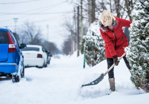 woman-shoveling-her-parking-lot-P9WKLMC